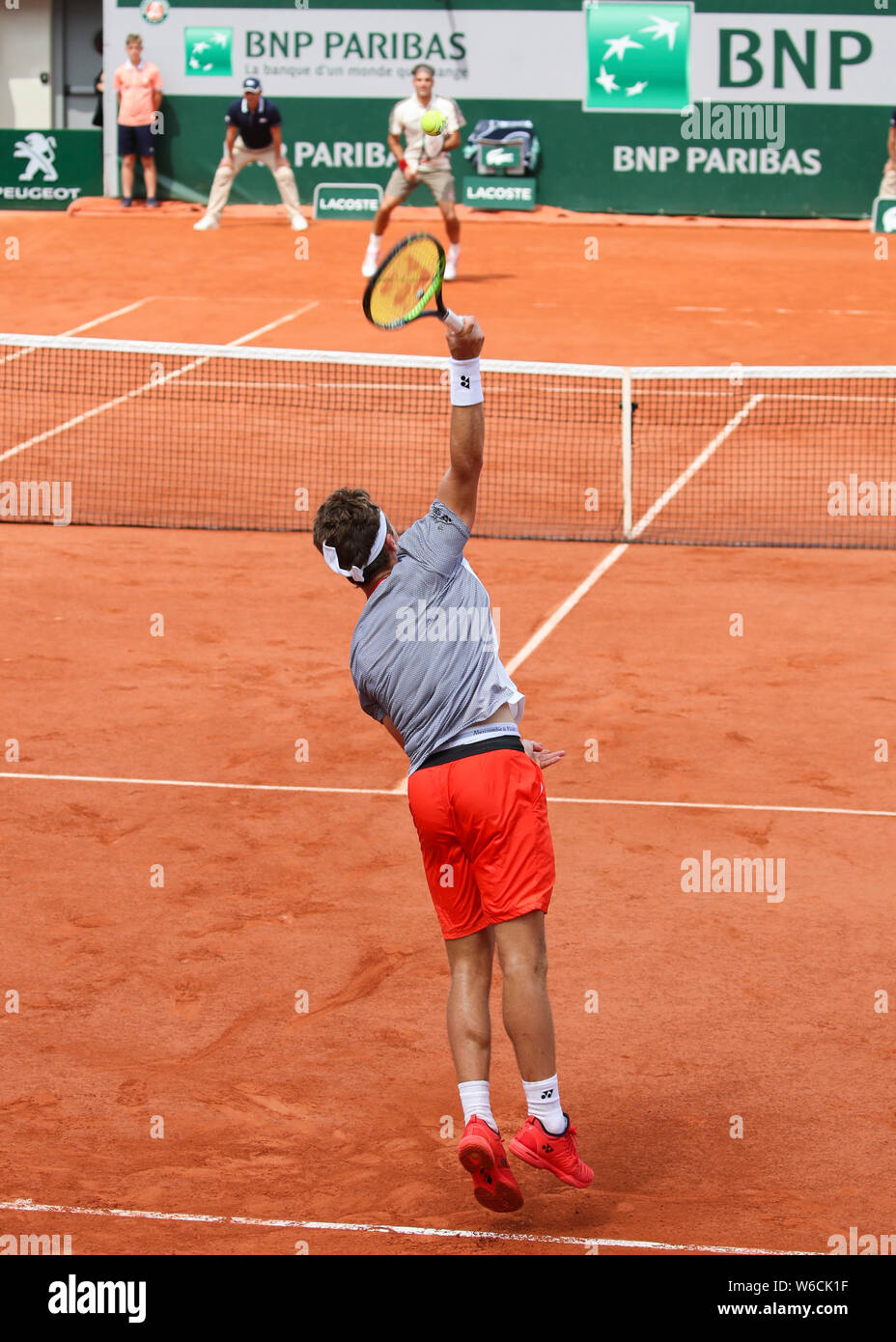 Norwegian Tennis Player Casper Ruud Playing A Service Shot To Roger Federer At The French Open 2019 Paris France Stock Photo Alamy