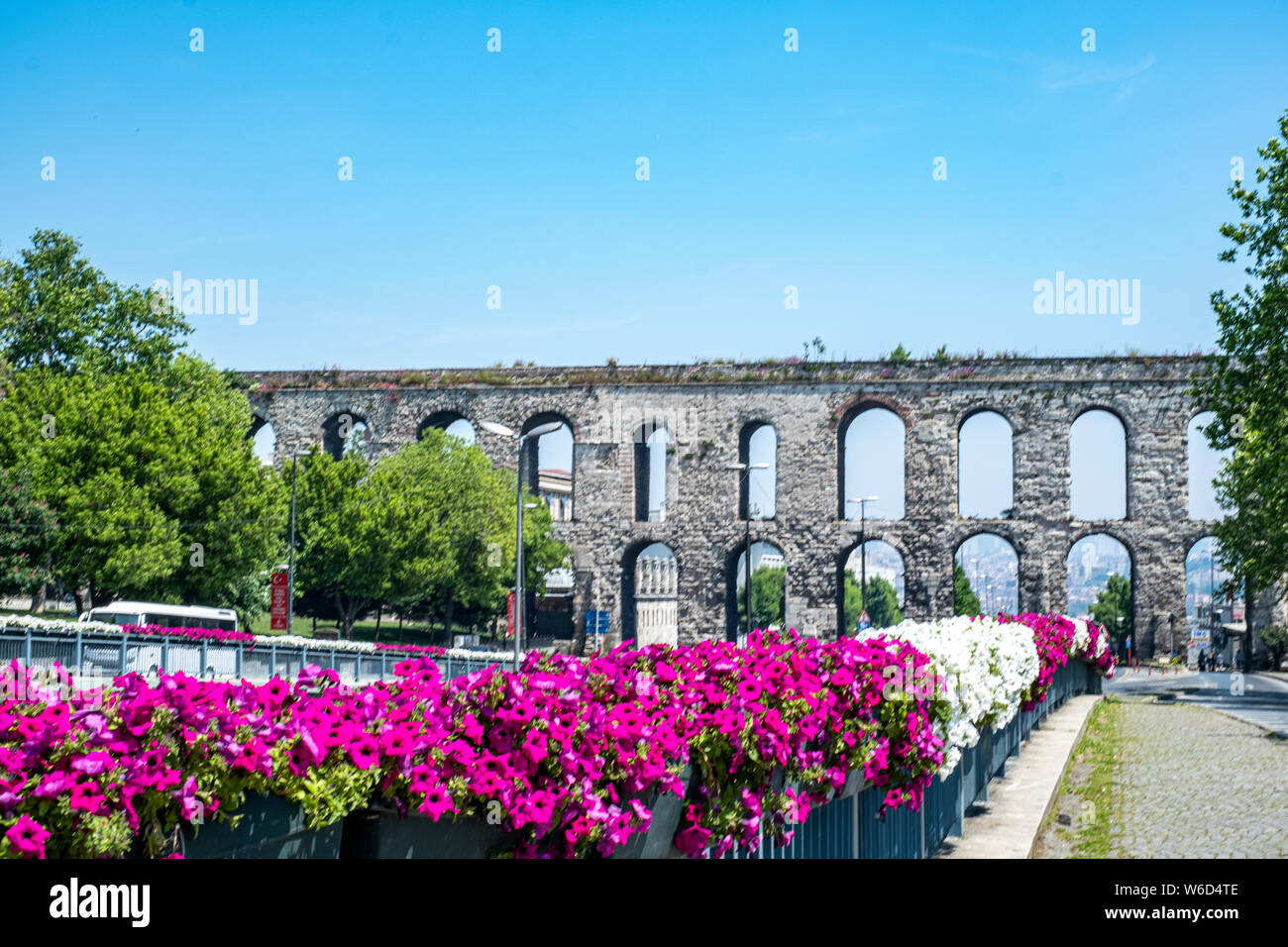 The Valens Aqueduct built by the Romans and towering over the modern city of Istanbul, Turkey in the springtime on a sunny day. Stock Photo