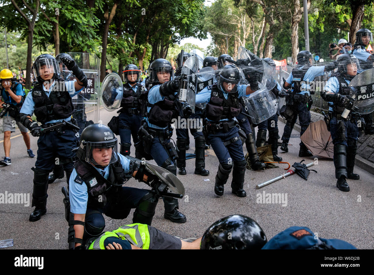 Police officers in riot gear clash with protesters during