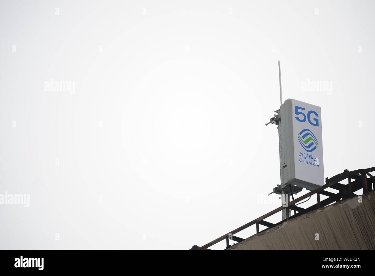 FILE--Logos of 5G and China Mobile are seen on the rooftop of a