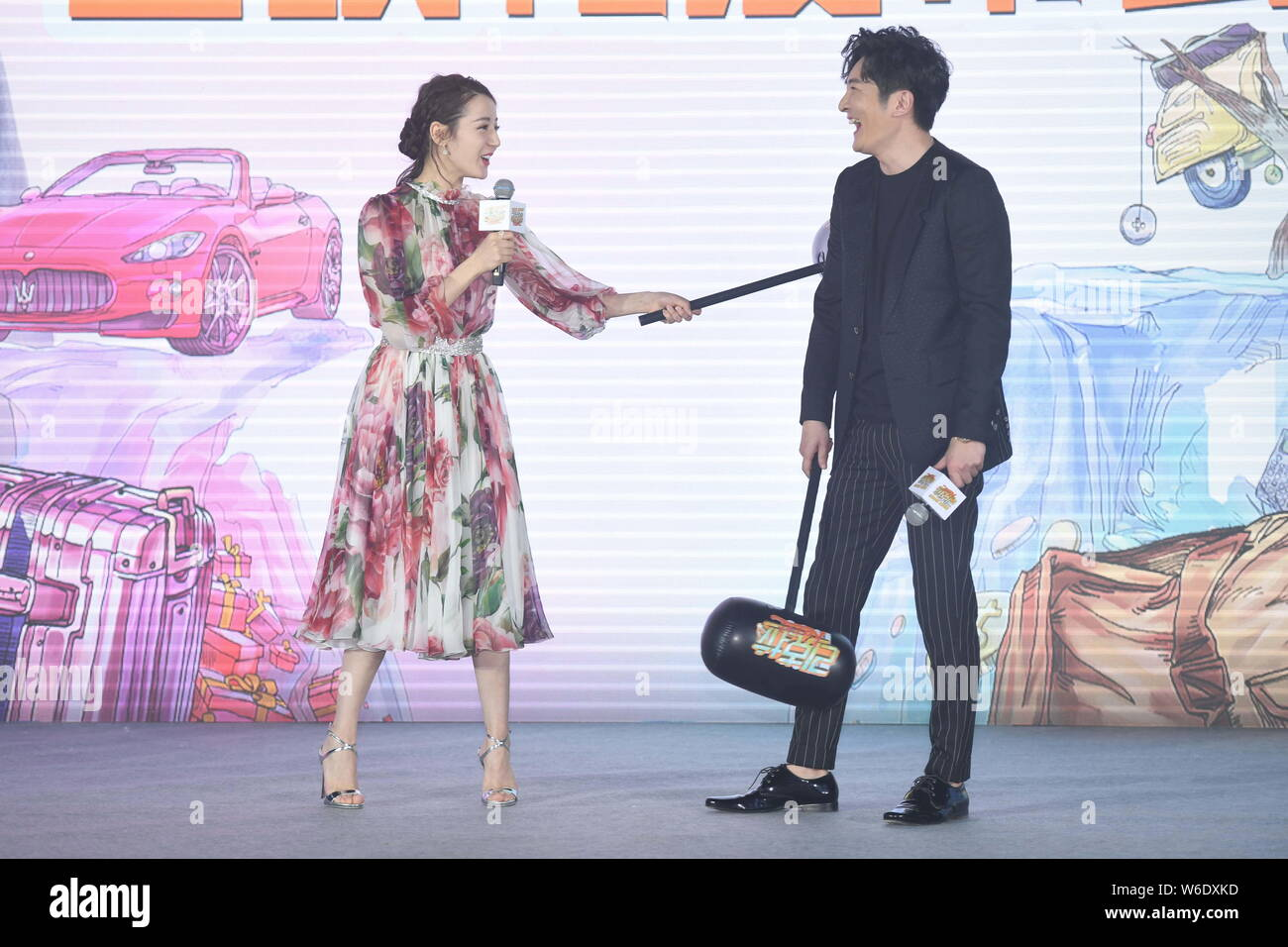 "Chinese Uigur actress Dilraba Dilmurat and Chinese actor Guo Jingfei attend the premiere event for the movie ""21 Karat"" in Beijing, China, 16 April 20 Stock Photo"