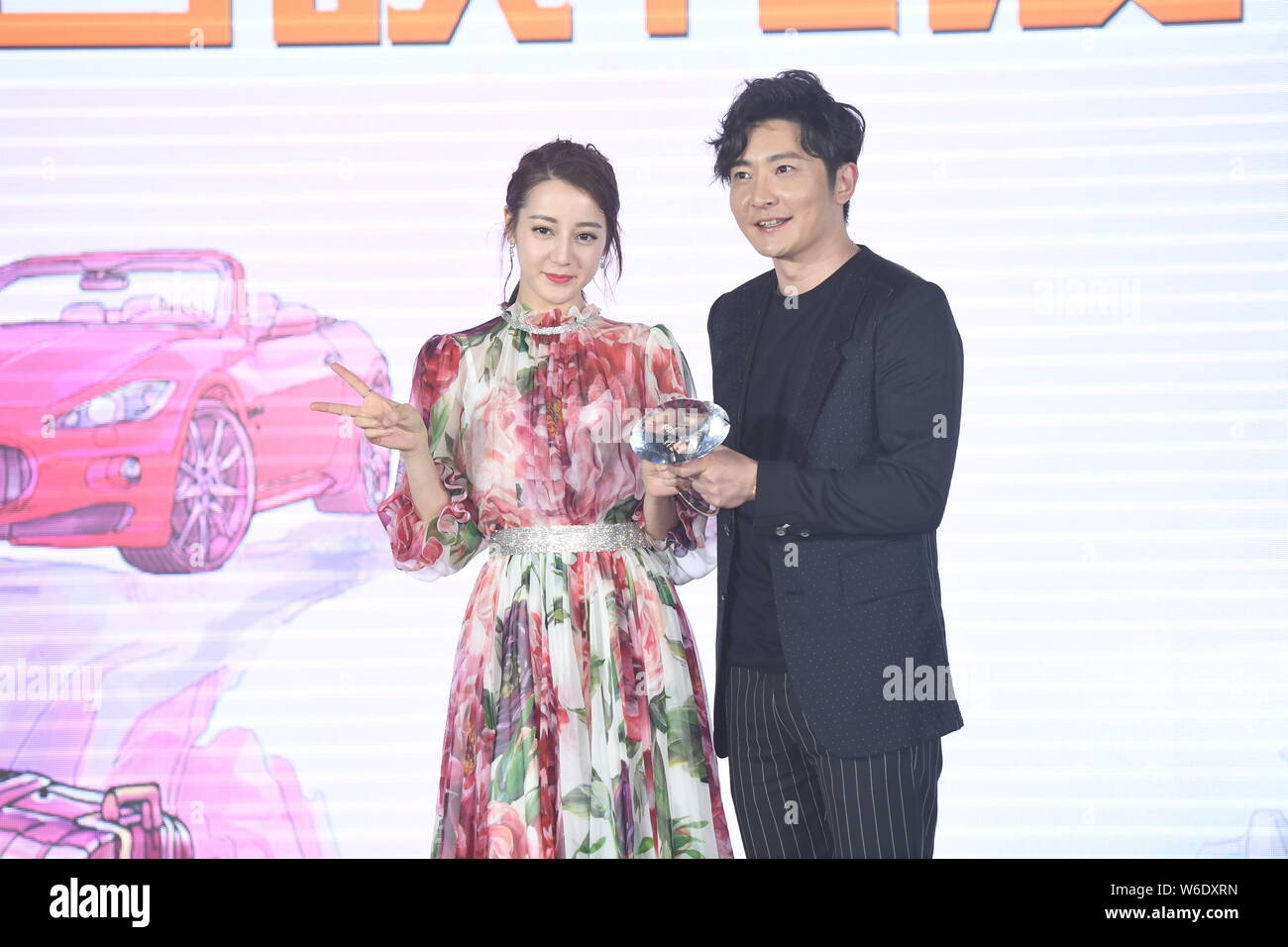 """Chinese Uigur actress Dilraba Dilmurat and Chinese actor Guo Jingfei attend the premiere event for the movie """"21 Karat"""" in Beijing, China, 16 April 20 Stock Photo"""