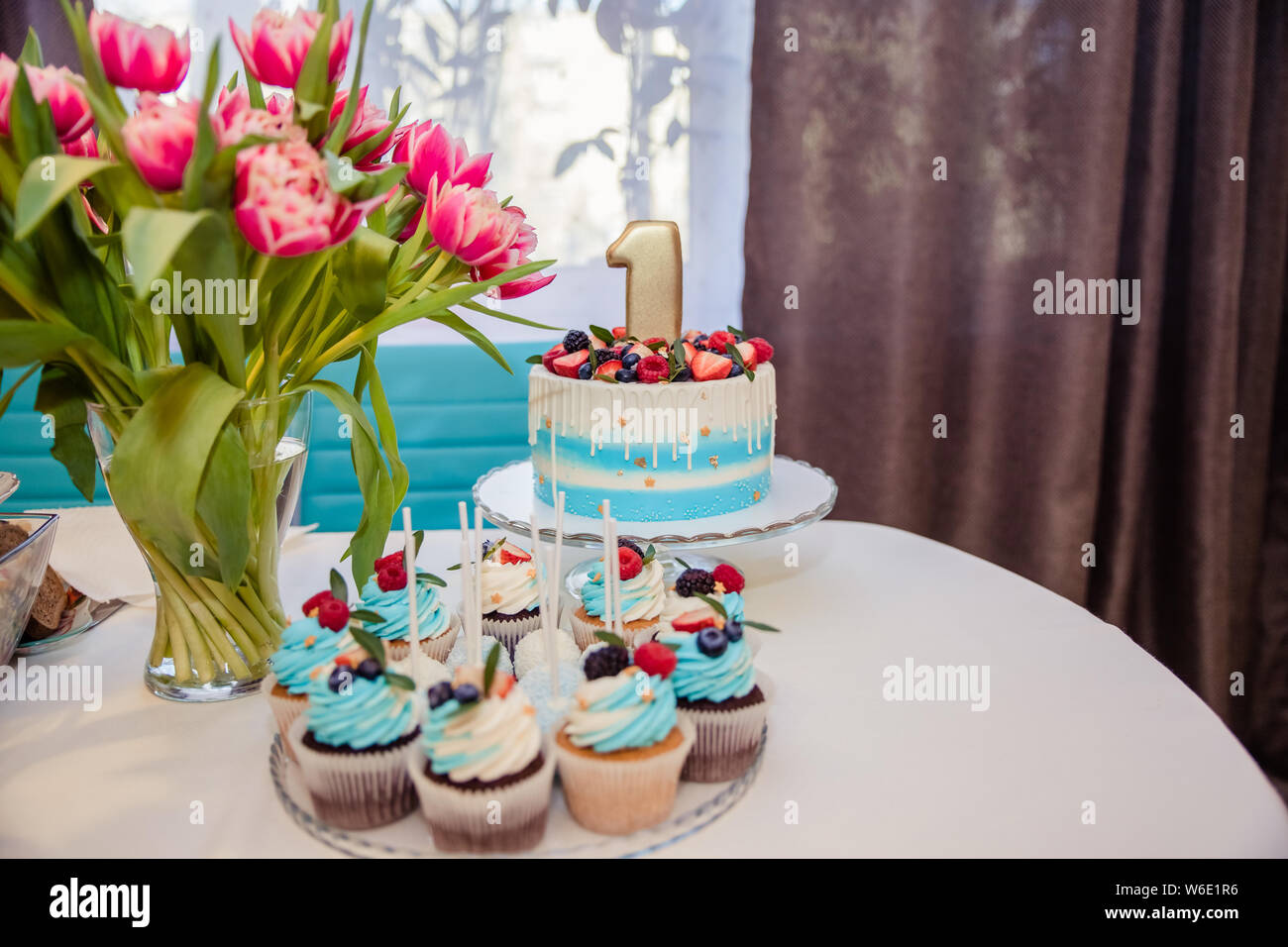 Candy bar decorated with sweets, cupcakes and cake for 17st