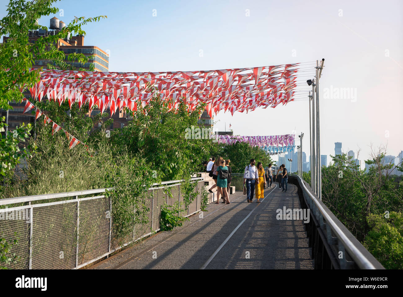 Chelsea High Line, view of people on a summer evening walking the High Line park in the Chelsea neighborhood of Manhattan, New York City, USA. Stock Photo