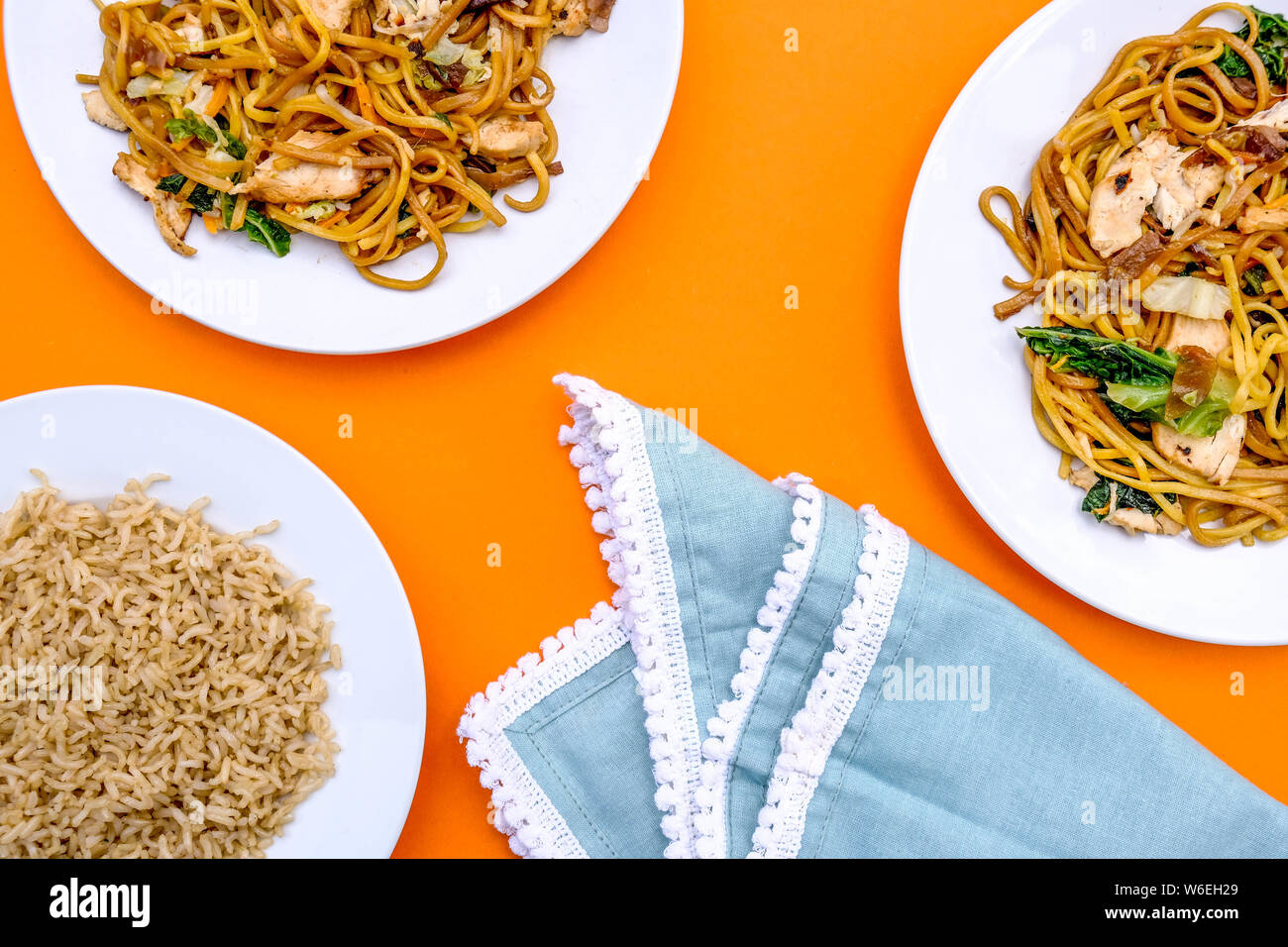Chinese Style Chicken Chow Mein Meal With Egg Noodles and Wholegrain Rice Stock Photo