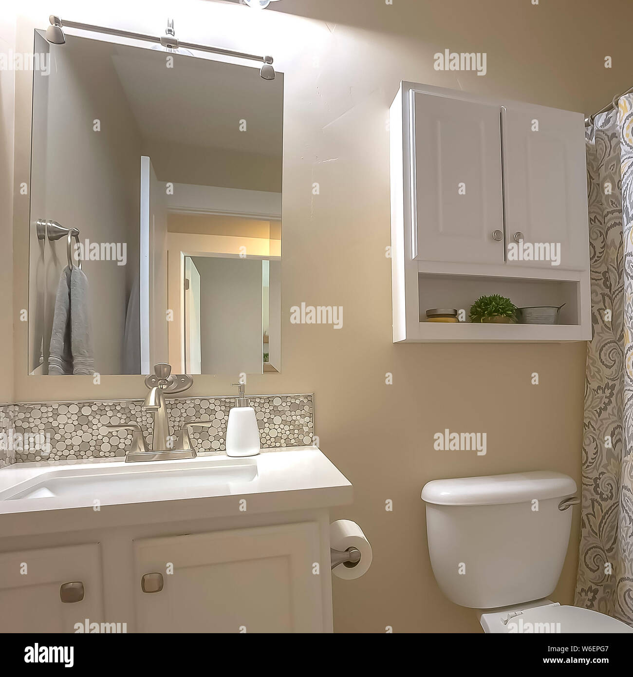 Square Toilet Vanity Mirror And Cabinet Inside Bathroom With Beige Wall And Tile Floor Stock Photo Alamy