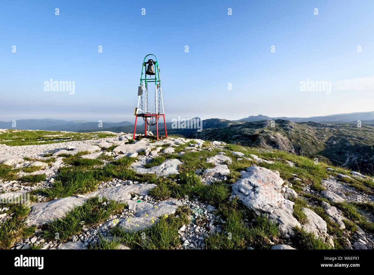The bell on the top of Mount Ortigara remembers the bloody battles of the Great War. Asiago plateau, Vicenza province, Veneto, Italy, Europe. Stock Photo