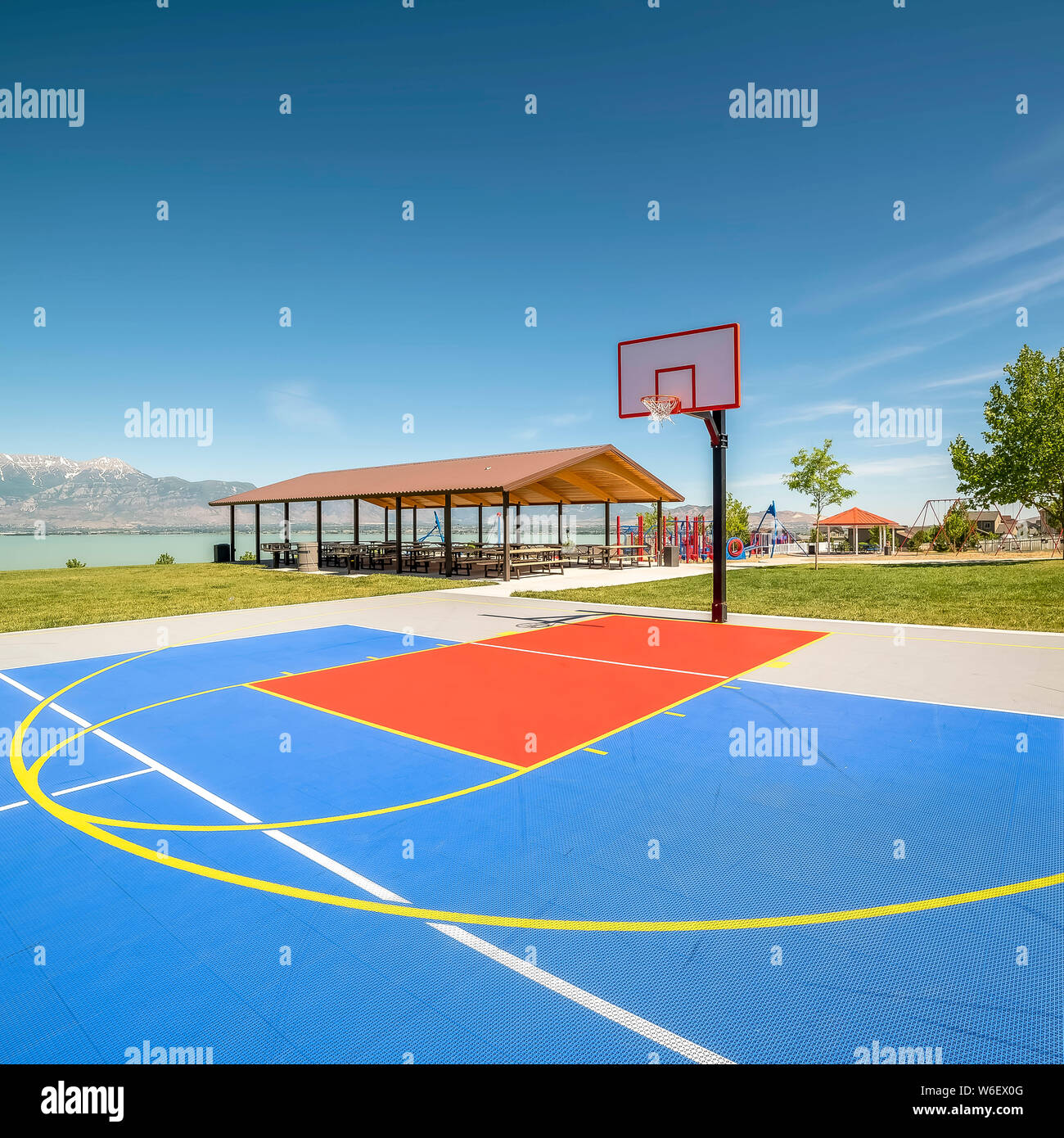 Square Frame Outdoor Basketball Court With A Picnic Pavilion And Playground In The Background Stock Photo Alamy