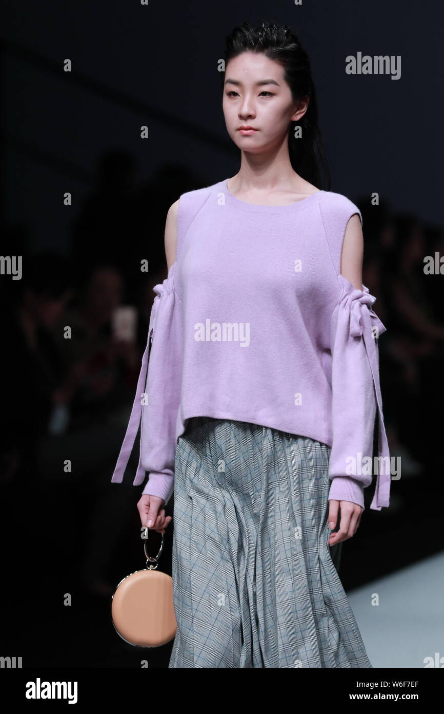 A model displays a new creation at the fashion show of H DEDUCT by Zeng Liping during the China Fashion Week Fall/Winter 2018 in Beijing, China, 30 Ma Stock Photo