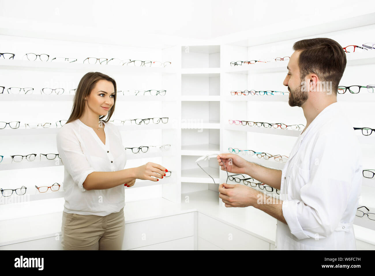Woman choose glasses at ophthalmology clinic Stock Photo