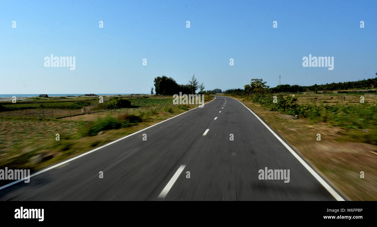 Road on the Champagne Trail between Festigny and Leuvigny villages in Bangladesh. Stock Photo