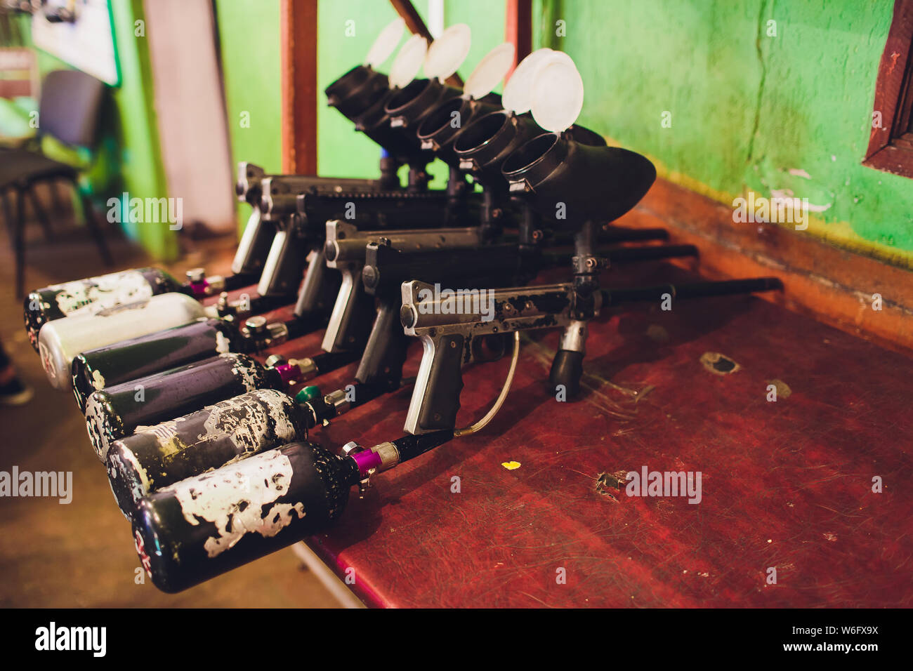 Paintball guns on a wooden table. play paintball. Stock Photo