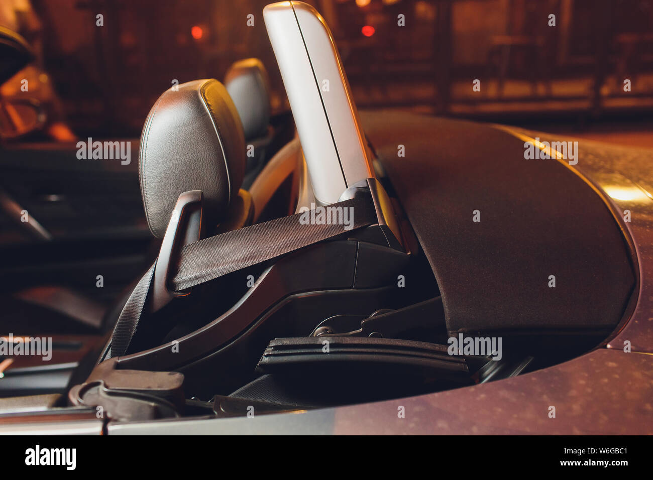 Convertible car's system with soft top closing opening. Stock Photo