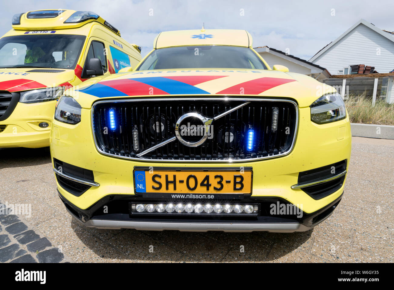 Dutch ambulance Volvo XC90 with active blue emergency lighting Stock Photo