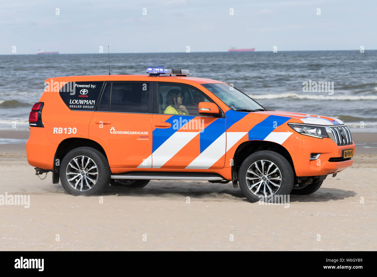 Dutch lifeguard Toyota Land Cruiser with active blue emergency lighting on the beach Stock Photo