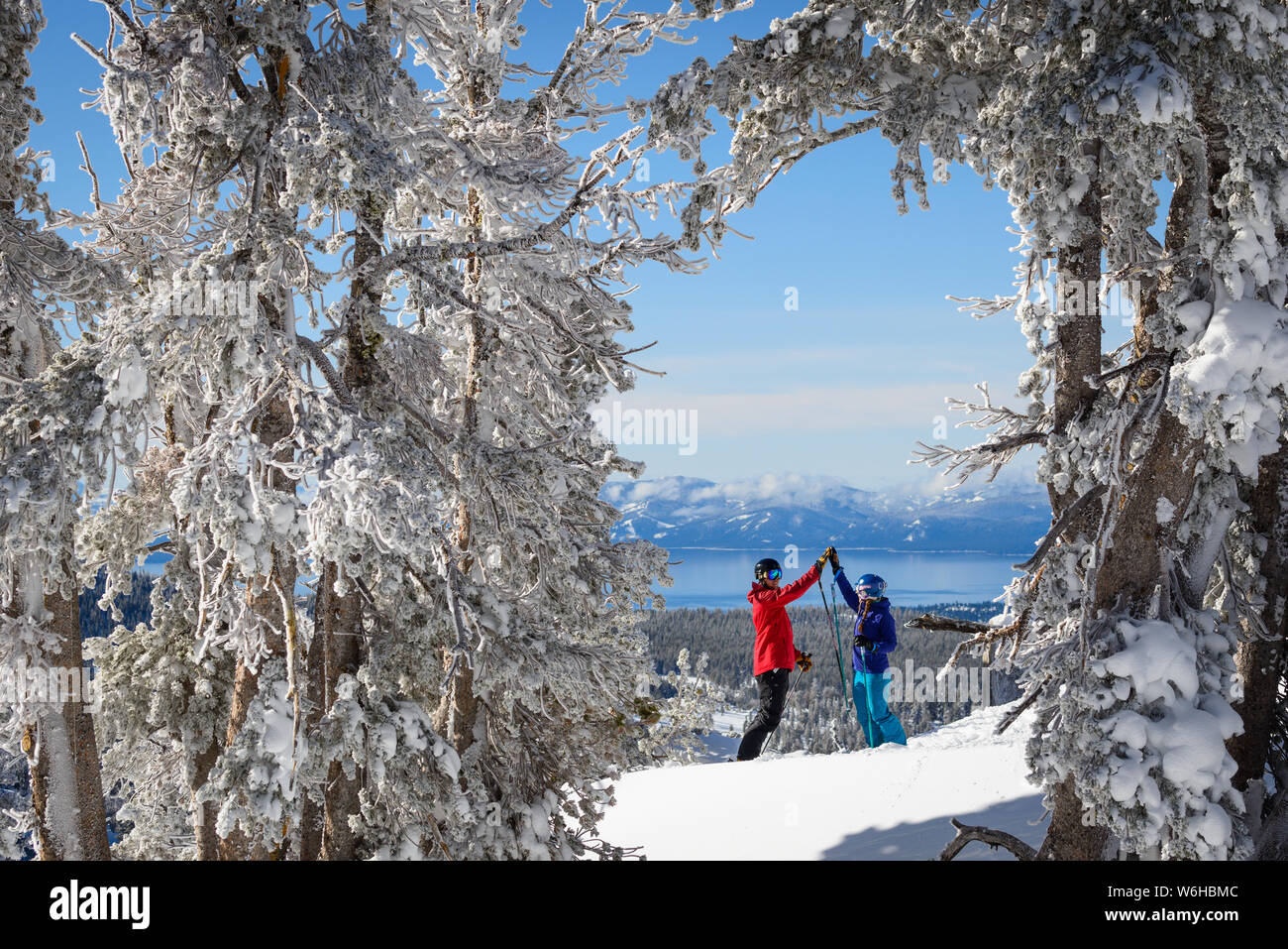 Skiing and snowboarding at Mt. Rose Ski Tahoe with fresh snow and Lake Tahoe views. Stock Photo