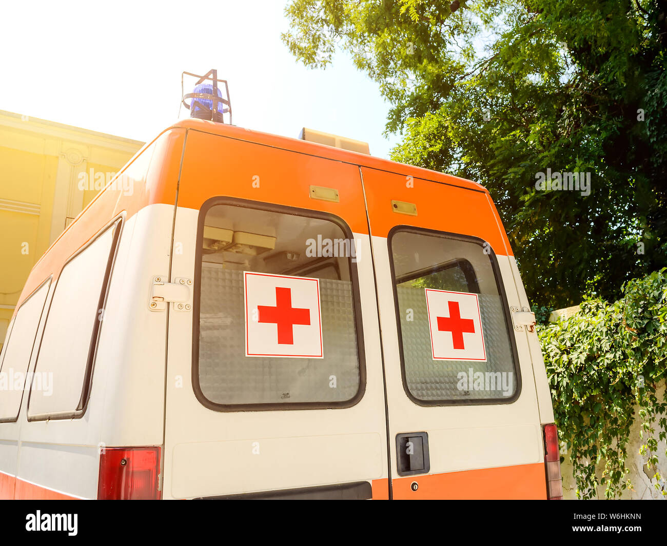 Varna, Bulgaria, July 22, 2019. Stationary white ambulance car with red cross on the windows on a sunny summer day. An emergency medical service van. Stock Photo
