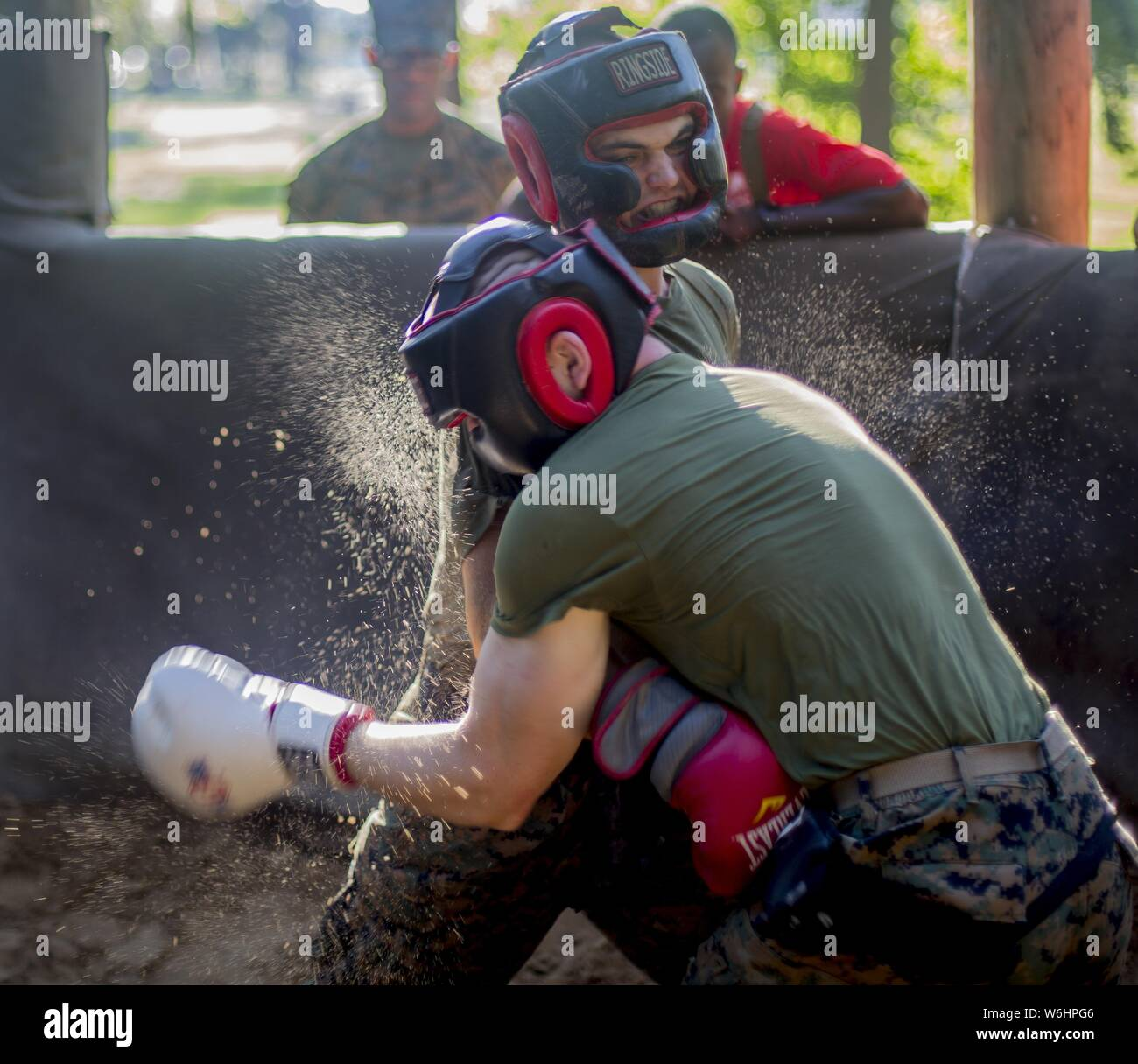 U.S. Marine Corps recruits with Delta Company, 1st Recruit Training Battalion, practice the fundamentals of body sparring at Marine Corps Recruit Depot Parris Island, South Carolina, July 25, 2019, July 25, 2019. Body sparring is an exercise that exemplifies the fundamentals of Marine Corps Martial Arts and forces recruits to overcome physical and mental fatigue. (U.S. Marine Corps photo by Lance Cpl. Dylan Walters). () Stock Photo