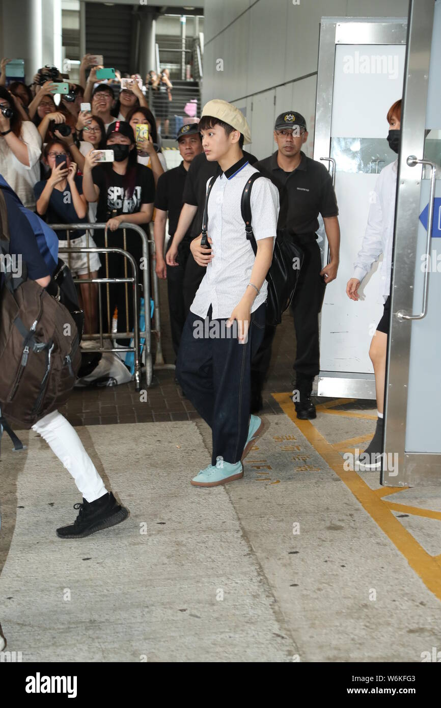 Members of South Korean boy group NCT 127 arrive at the Hong
