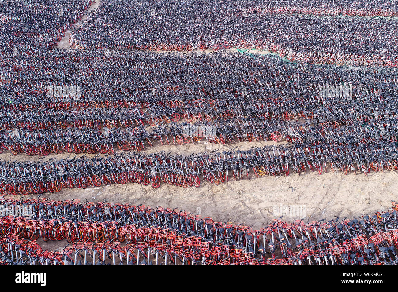 Thousands of bicycles of bike-sharing service Mobike are lined up at an open space in Yinchuan city, northwest China's Ningxia Hui Autonomous Region, Stock Photo