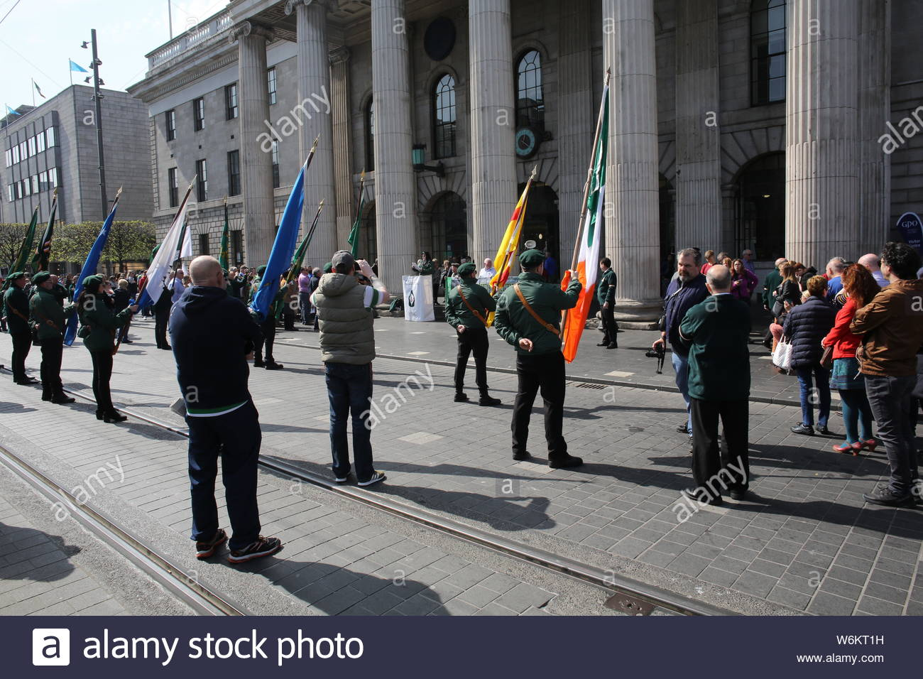 A military parade has taken place in Dublin to commemorate the 1916 Rising. Activists in military style uniform marched through Dublin followed by a s Stock Photo