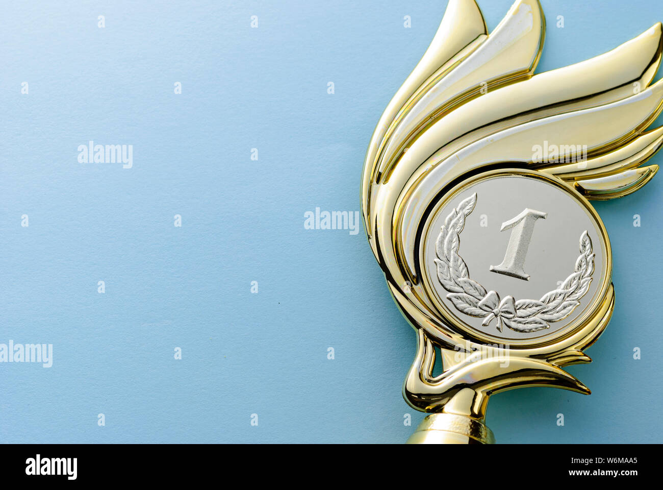 Gold Medallion Winners Trophy With Laurel Wreath For The Winner Of A Competition Of Championship Event Over Grey With Copy Space Stock Photo Alamy