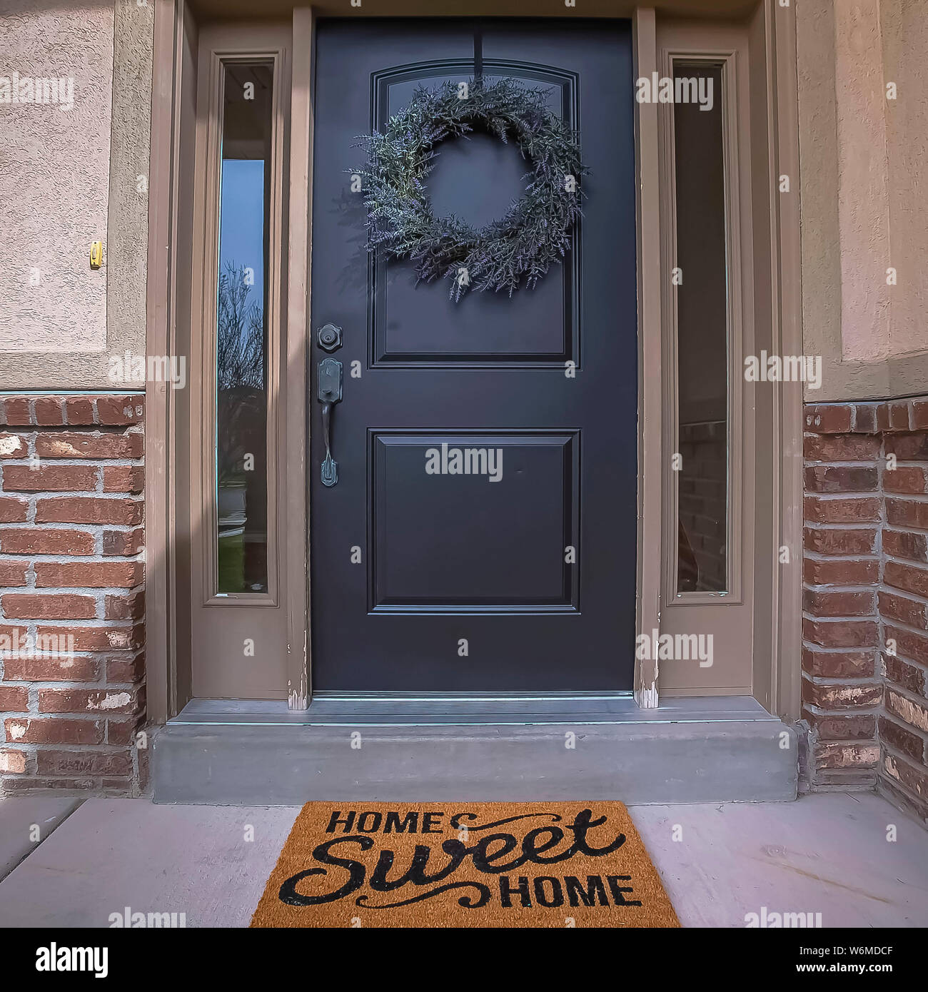 Square Wreath And Doormat On The Front Door With Sidelights And Transom Window Stock Photo Alamy