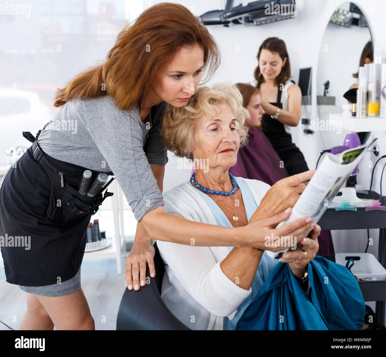 Incredible Smiling Elderly Female Client Sitting In Chair With Magazine Download Free Architecture Designs Rallybritishbridgeorg