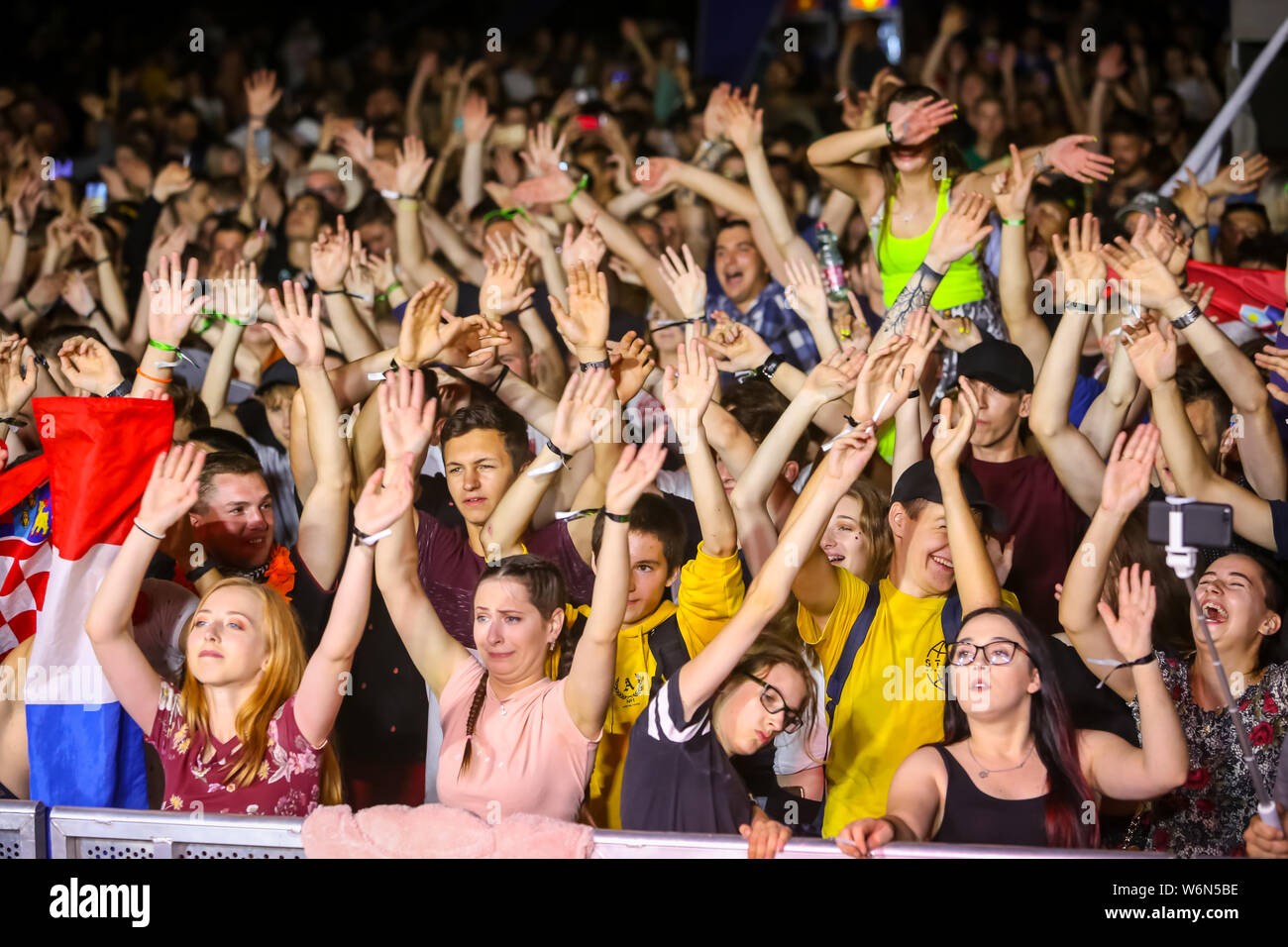 Brezje, Croatia - 20th July, 2019 : People dancing left, right with hands up during the Forestland, ultimate forest electronic music festival located Stock Photo