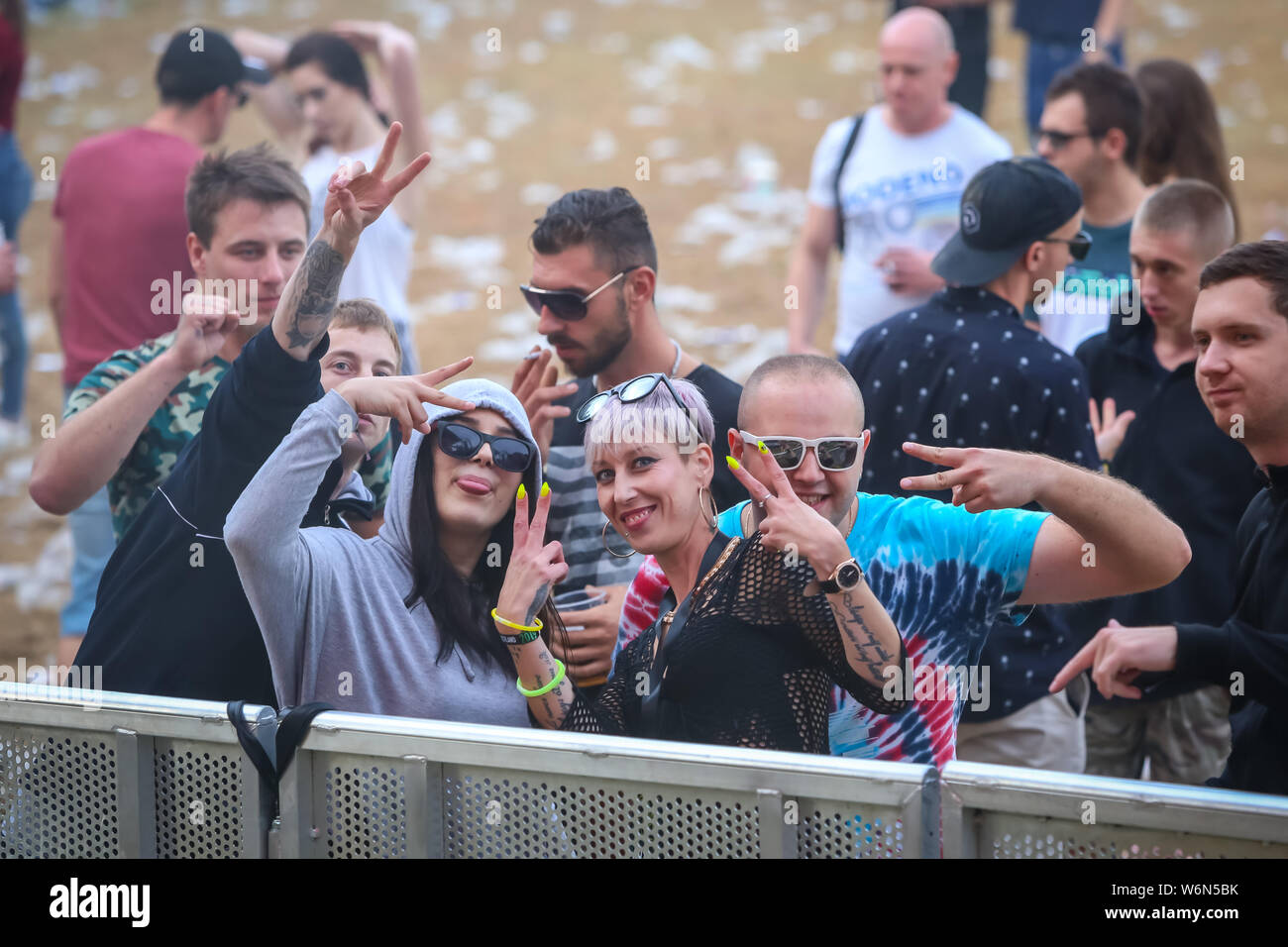Brezje, Croatia - 20th July, 2019 : Audience posing with hands up in the morning of the Forestland, ultimate forest electronic music festival located Stock Photo