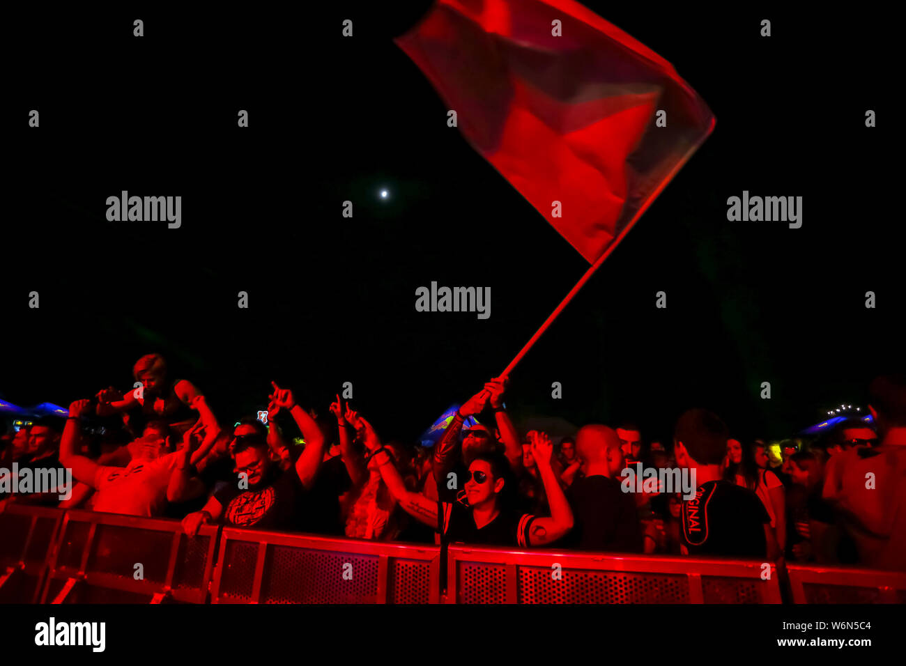 Brezje, Croatia - 20th July, 2019 : Audience with flag dancing during the Forestland, ultimate forest electronic music festival located in Brezje, Cro Stock Photo