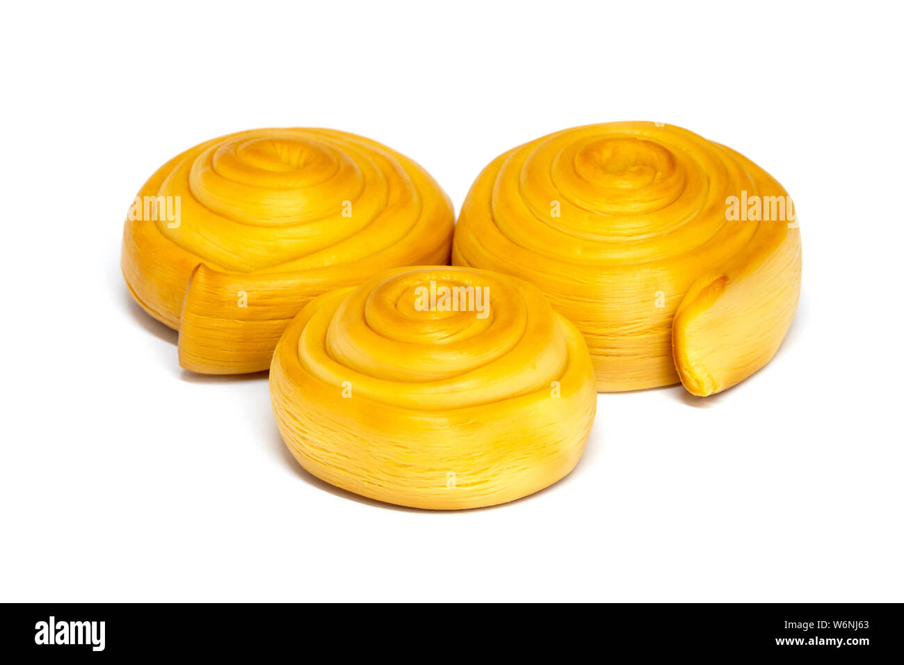 Parenica, a traditional Slovak smoked cheese, on a white background Stock Photo