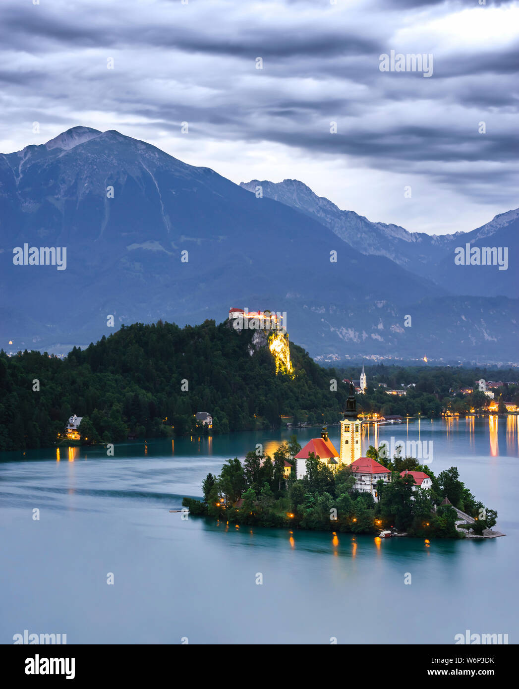 my journey to bled, seen from the top of a forest where you can see the church immersed in the lake Stock Photo