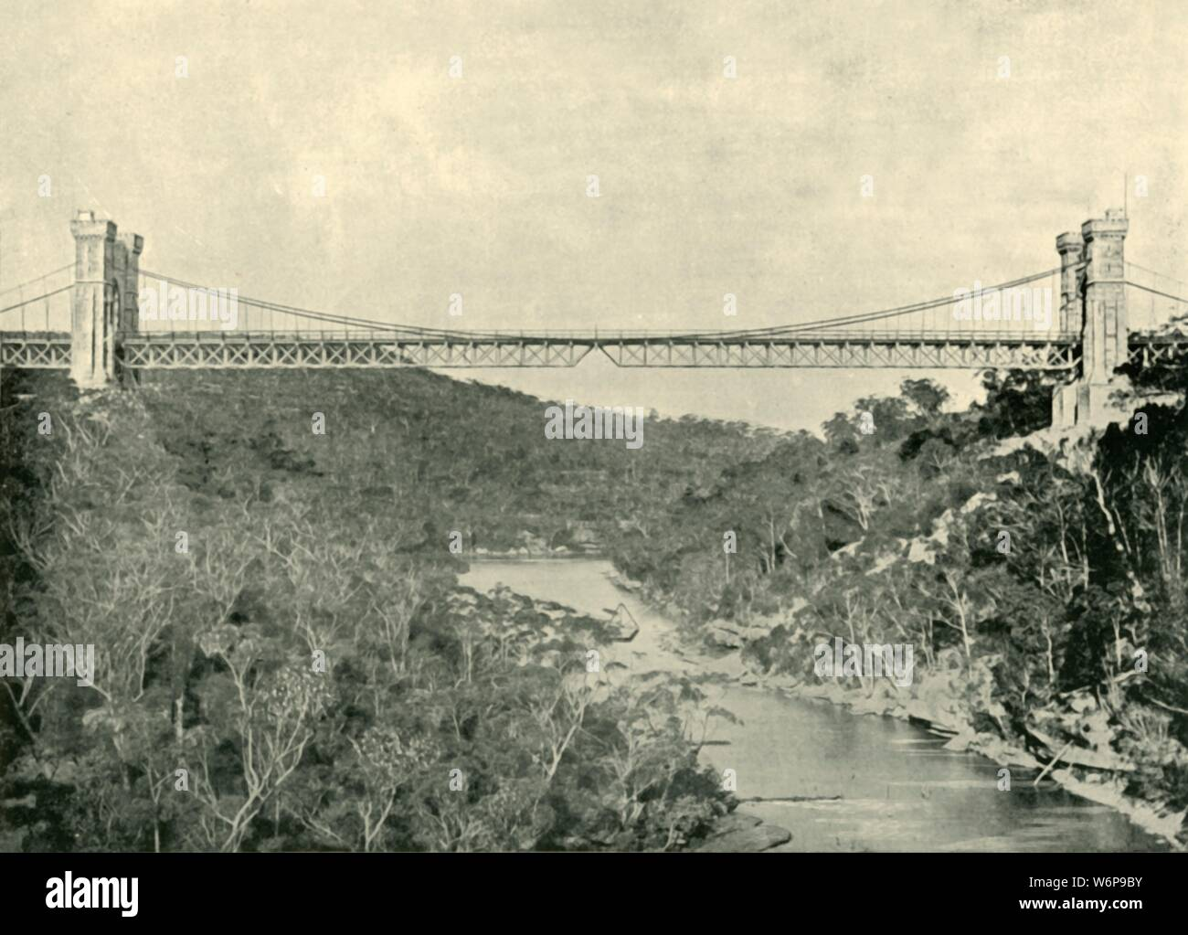 "'Suspension Bridge, North Sydney', 1901. Suspension Bridge known as the Long Gully Bridge, connecting Cammeray and Northbridge a suburb of Sydney over the  Murray River, built in 1889. From ""Federated Australia"". [The Werner Company, London, 1901] Stock Photo"