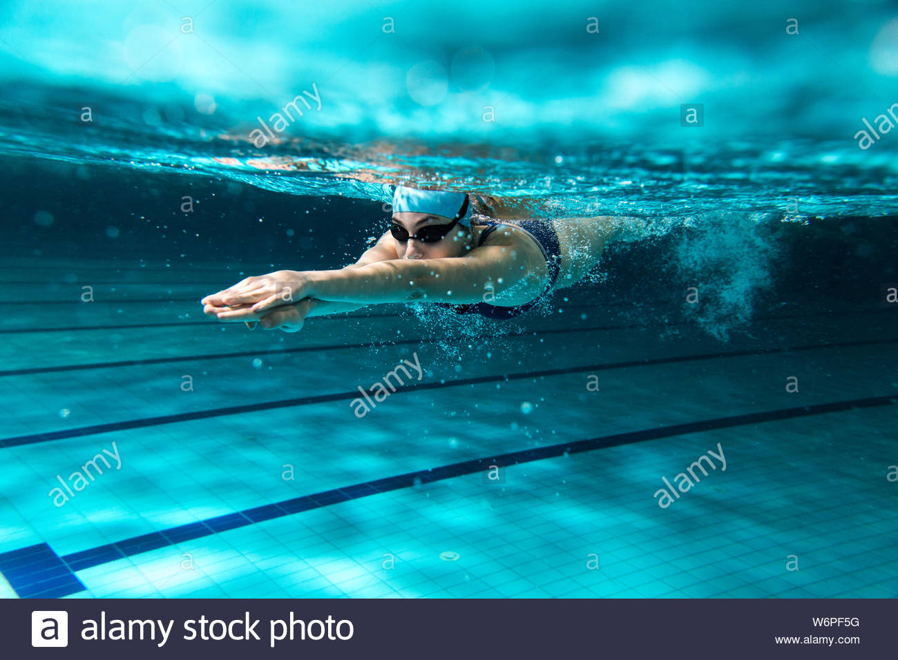Swimmers at the swimming pool.Underwater photo Stock Photo