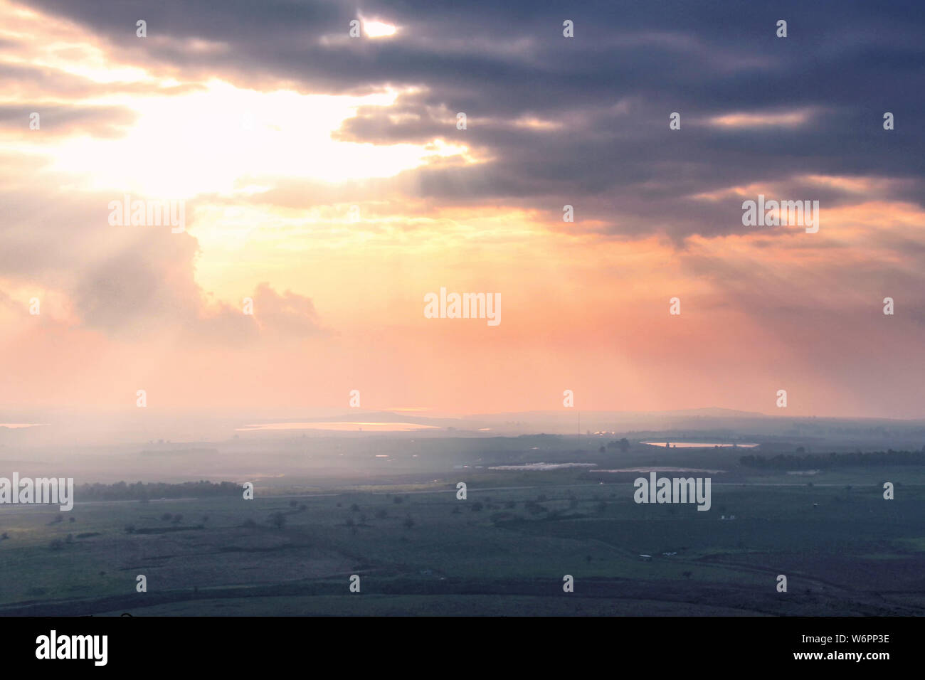 A view of the Golan Heights of Israel at sunset on a cloudy day from Tel Fares near the Syrian border. Stock Photo