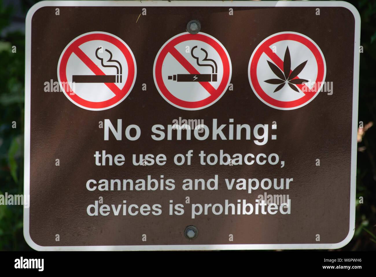 No Smoking, vaping, or use of weed/marijuana/pot/cannabis sign in a local park. Stock Photo