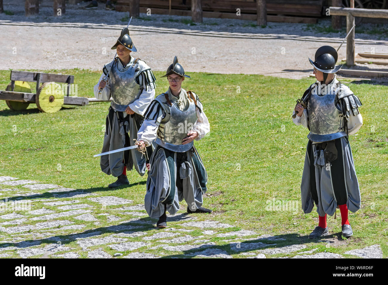 Rakvere, Estonia, June 28: A cuirassier squad staged a show in the courtyard of an old castle in Rakvere, June 28, 2019. Stock Photo