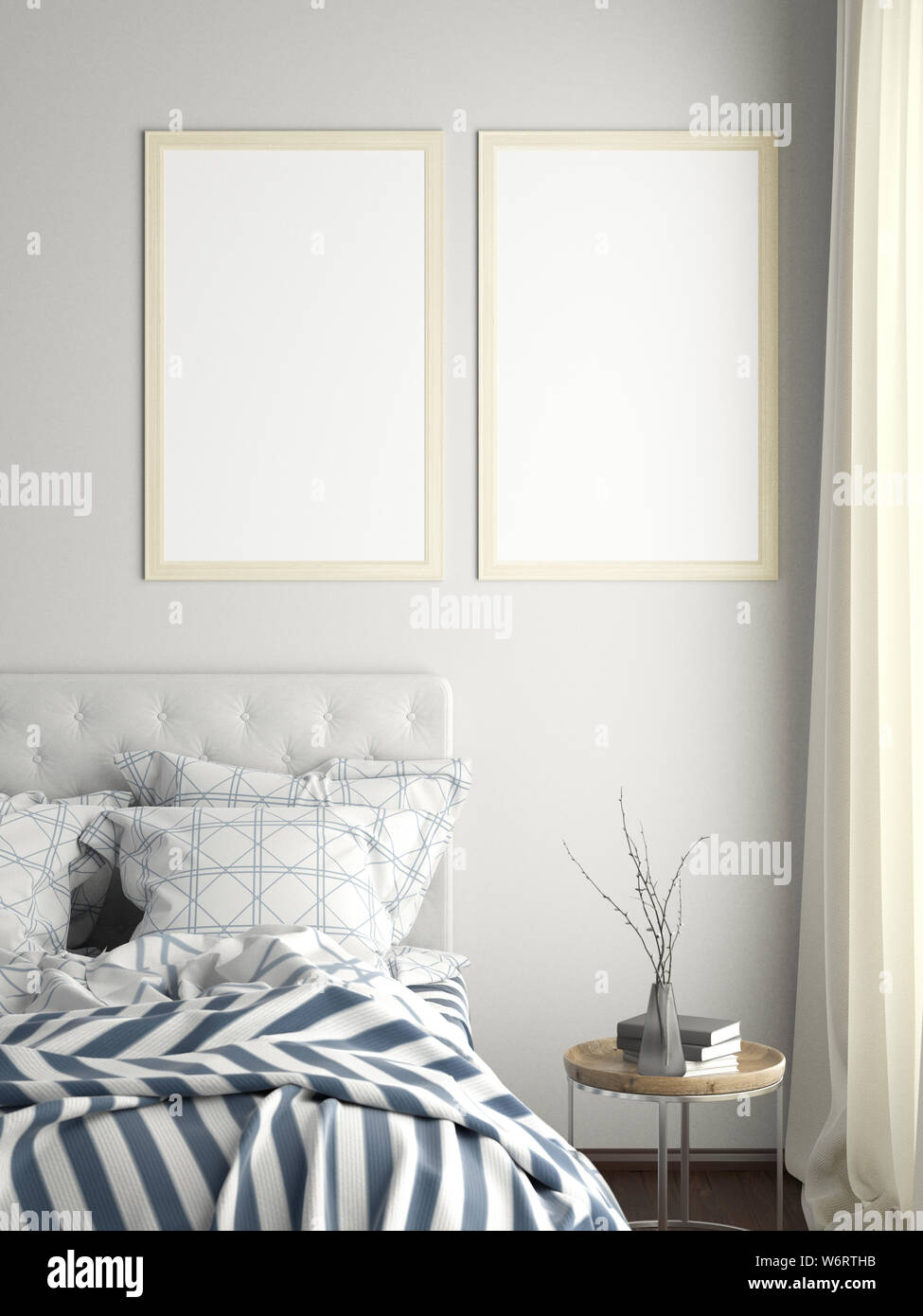 Two blank vertical posters frames mock up on white wall in ...