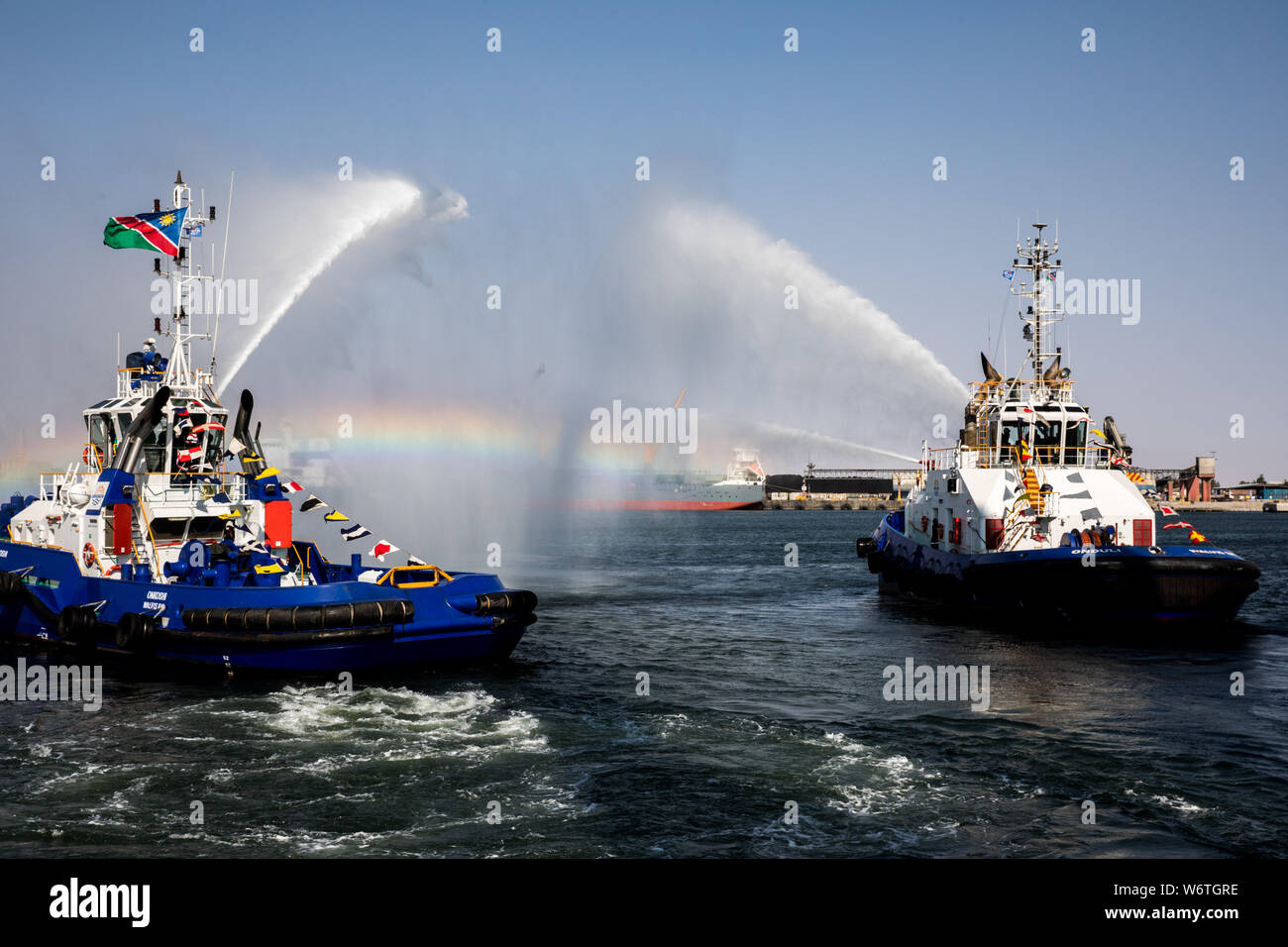 (190802) -- WALVIS BAY (NAMIBIA), Aug. 2, 2019 (Xinhua) -- Fire boats perform during the inauguration ceremony of the new container terminal in Walvis Bay, Namibia, Aug. 2, 2019. Namibia's quest to become an international trade hub and gateway advanced further Friday with the official inauguration of the country's 400-million-U.S.-dollar new container terminal in Walvis Bay by the county's President Hage Geingob. The new container terminal located in the port town of Walvis Bay was constructed on 40 hectares of land reclaimed from the sea by China Harbor Engineering Company Ltd (CHEC) under ju Stock Photo