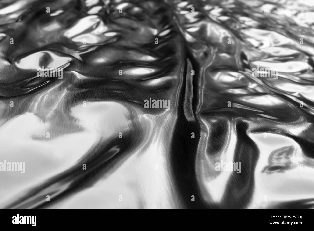 Close up of black textured rubber background. Abstract black rubber film texture background. Rubber film close up. Rubber film for the pond Stock Photo