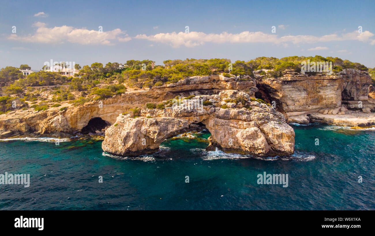 Rocky Arch in the sea, view from sea. Popular tourist destinations. Amazing natural wonder. Mirador Es Pontas, Samtanyi, Mallorca, Balearic Islands Stock Photo