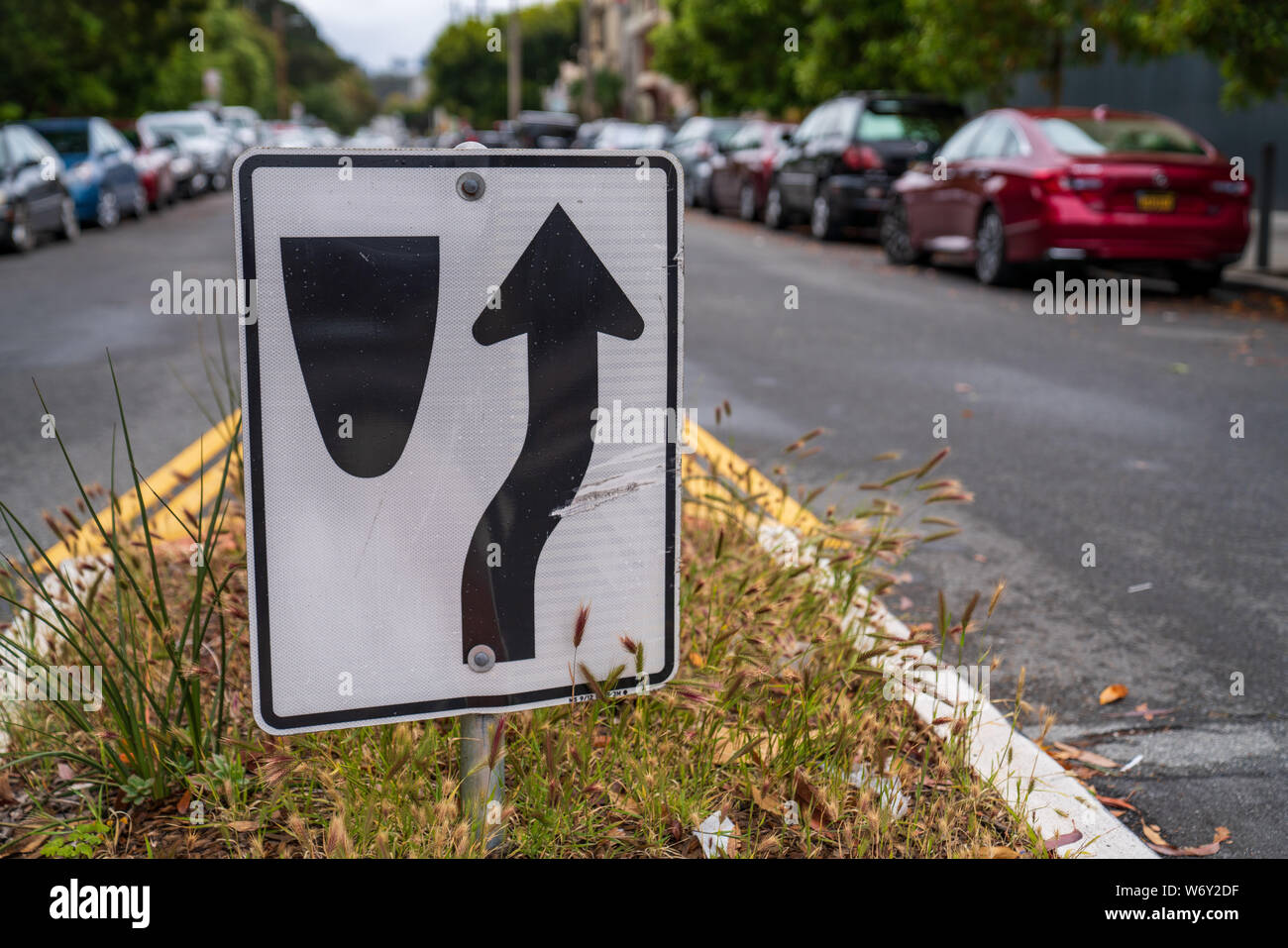 Cars To Go >> Traffic Sign Directing Cars To Go To Right Of Median Along