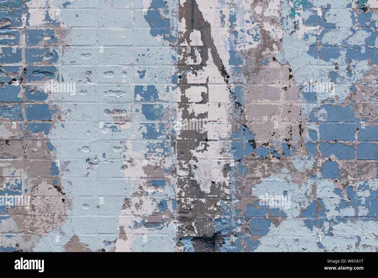 Abstract background of an old brick wall with expressive spots in gray and blue colors. Inimitable pattern Stock Photo