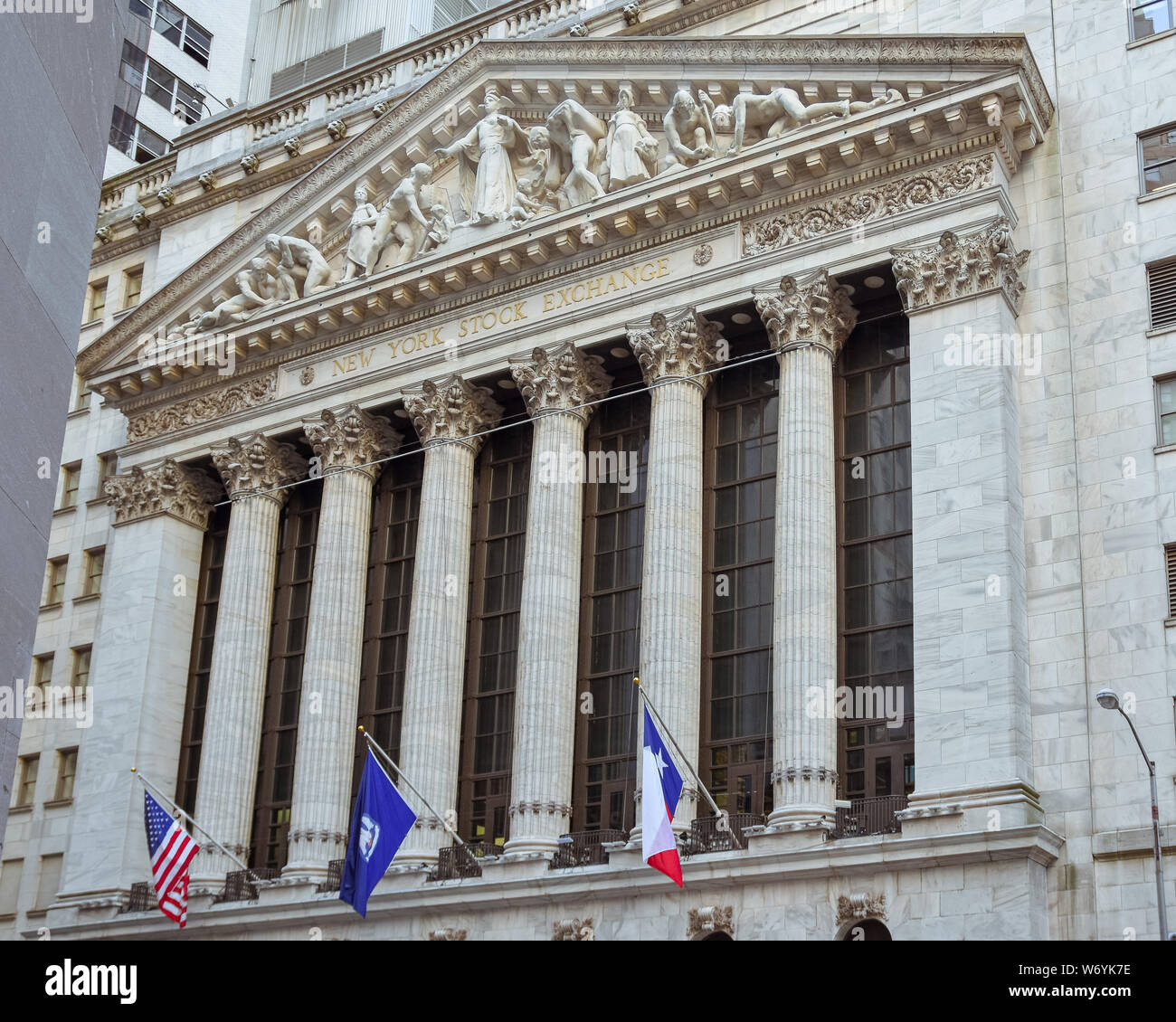 Famous Wall street and the building New York Stock Exchange. Main facade. Stock Photo