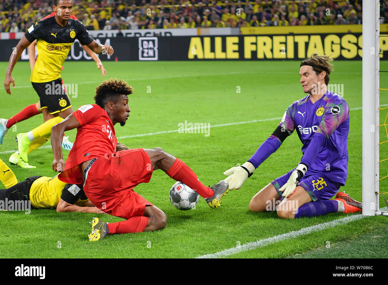 Dortmund, Germany. 3rd Aug, 2019. Goalkeeper Marwin Hitz (down R ...