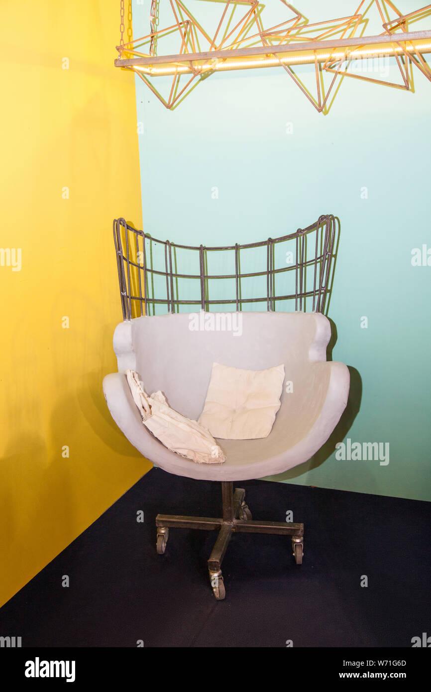 modern decorative armchair on bright background in studio Stock Photo