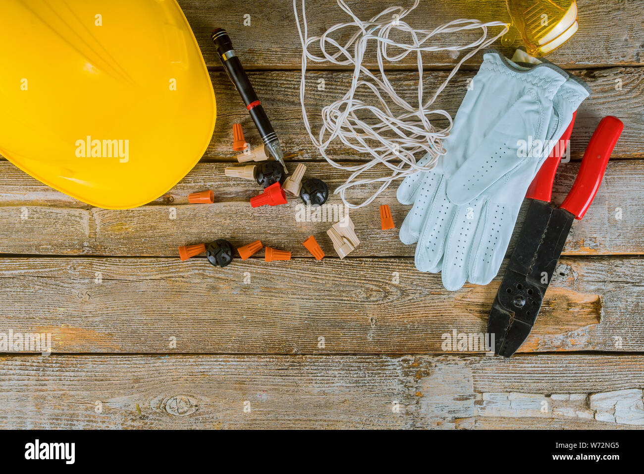 Electrician Technician At Work Prepares The Tools And Cables Used In Electrical Home Installation And Yellow Helmet Stock Photo Alamy