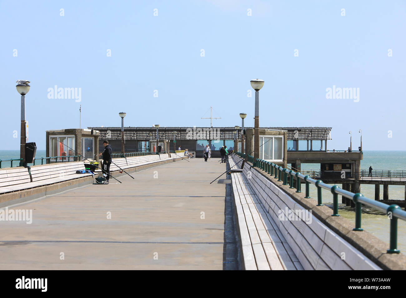 Fishing on the pier and the trendy Deal Pier Kitchen in the seaside town, in east Kent, UK Stock Photo