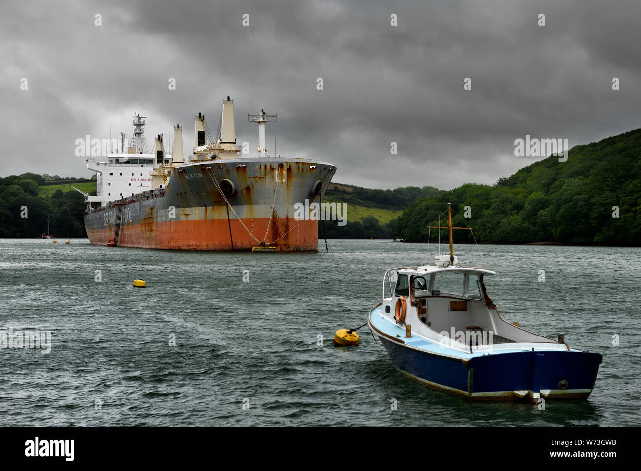 Small boat and bulk carrier SSI RELIANCE Alkyon Sea Stallion Pool moored in the River Fal at the King Harry Ferry Truro United Kingdom Stock Photo